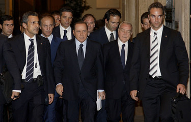 Italy's Prime Minister Silvio Berlusconi leaves his residence of Grazioli Palace in Rome