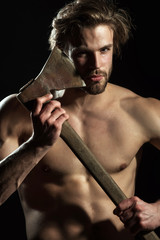 Sharp razor ax for bearded young sexy man. Naked man with an ax near his face. Dangerous attractive sports guy. Exciting danger
