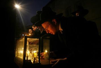 Ultra-Orthodox Jews light candles for Hanukkah in Jerusalem