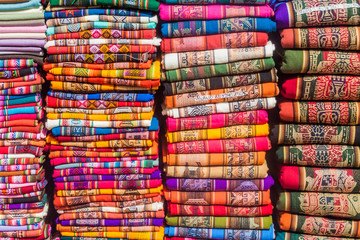 Piles of traditional textile products in Humahuaca village, Argentina