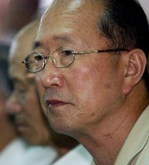 AN UNCONVERTED FORMER LONG-TERM PRISONER PONDERS AT A PRESS CONFERENCE IN SEOUL.