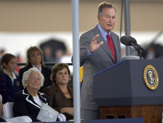 Former U.S. President George H.W. Bush speaks at ceremony to christen the U.S. Navy aircraft carrier George H.W. Bush in Newport News, Virginia