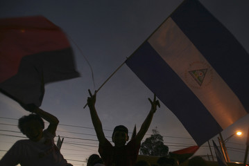 Supporters of Alexis Arguello attend a closing campaign rally in Managua