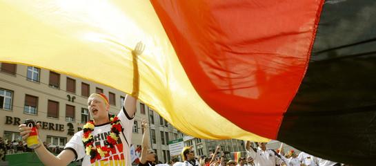 A German soccer fan celebrates before the Euro 2008 semi-final match with Turkey in Basel