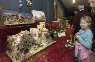 Handmade creches depicting the birth of Jesus Christ are on display during an exhibition of a creche crafting club in Vienna