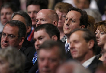 Britain's opposition Conservative Party leader Cameron and Shadow Foreign Secretary Hague listen during the Conservative Party conference in Manchester