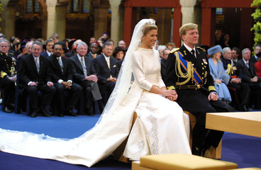Dutch Crown Prince Willem-Alexander holds hands with Maxima Zorreguieta during the civil wedding cer..