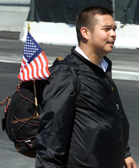 CUSTOMS OFFICER CARRIES FLAG AT NEW YORK'S KENNEDY AIRPORT.