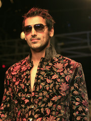 Bollywood actor Abraham presents creation from Indian designer Rohit Bal during grand finale of Kolkata fashion week