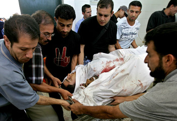 Palestinians carry bodies in Maghazi camp in Gaza