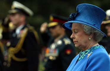 Britain's Queen Elizabeth stands in silence during her visit to the Commonwealth War Grave Cemetery ...