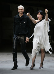 Austrian designers Hermann Fankhauser (L) and Helga Schania of design house Wendy & Jim appear at th..