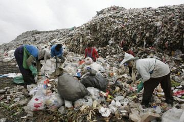 Thai rag-picker search for plastic waste at a garbage dump site in Thailand's Ayutthaya provinc