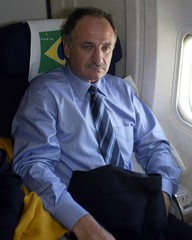A somber and exhausted Brazilian head soccer coach Luiz Felipe Scolari rests during his team's fligh..