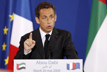 France's President Nicolas Sarkozy addresses UAE and French officials at the Emirates Palace in Abu Dhabi