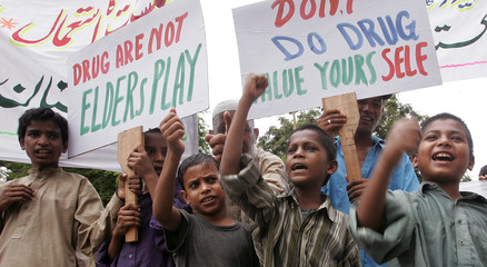 Street children take part in rally to mark United Nations International Day against Drug Abuse and Illicit Drug Trafficking in Karachi