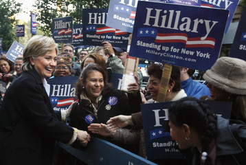 U.S. Senator Hillary Rodham Clinton greets supporters before her debate with Republican challenger John Spencer in New York