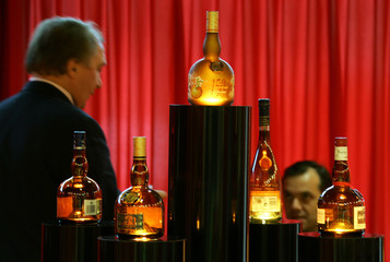 Buyers browse at an alcohol stand during the TFWA exhibition in Cannes