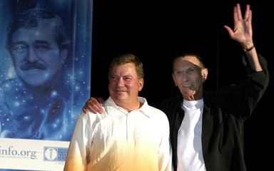 """Spock"" and ""Captain Kirk"" wave on stage at a Star Trek convention in Hollywood."