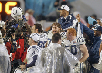 Colts head coach Dungy is hoisted up by teammates after winning the NFL's Super Bowl XLI game against the Bears in Miami