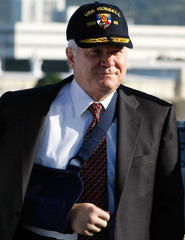 US Defense Secretary Gates wears a USS Russell hat while touring the ship at Pearl Harbor Naval Base in Honolulu