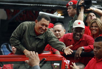 Venezuelan President Chavez greets supporters as he campaigns for  yes vote for upcoming referendum in Caracas
