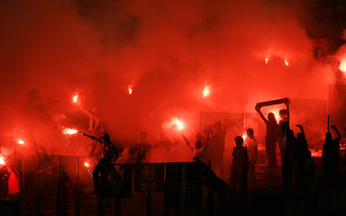 Real Madrid supporters wave flares at the start of their Champions League Group C soccer match against Lazio at the Olympic stadium in Rome