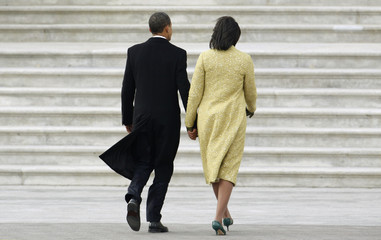 President Barack Obama and first lady Michelle Obama, dressed in Isabel Toledo, walk away after former President Bush departed during the inauguration ceremony in Washington