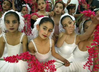Iraqi ballerinas pose following their performance on the opening day of the First Festival for Child..
