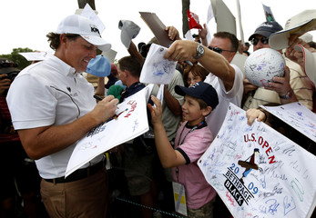 Phil Mickelson of the U.S. signs autographs for fans after completing his practice round for the U.S. Open golf championship on the Black Course at Bethpage State Park in Farmingdale