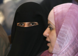 Two women attend the launch ceremony of the Arab Human Development Report in Sanaa