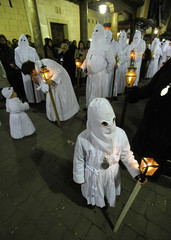 Penitents and their children take part in 'El Dolor' procession during Holy Week in Medina de Rioseco