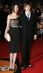 Singer Ellis-Bextor and husband Jones arrives for the Brit Awards at the Earls Court Arena in London