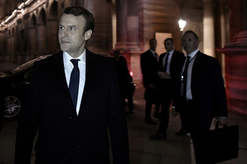 French President-elect Emmanuel Macron arrives to deliver a speech during his victory rally at the Louvre Museum after the results in the second round of the French presidential election, in Paris