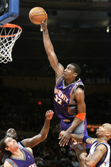 Phoenix Suns Stoudemire tries to dunk past New York Knicks Marbury.