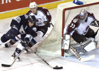 AVALANCHE'S SKOULA AND ROY KEEP OILERS' MOREAU AT BAY.