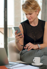 Business woman working  and using smart phone