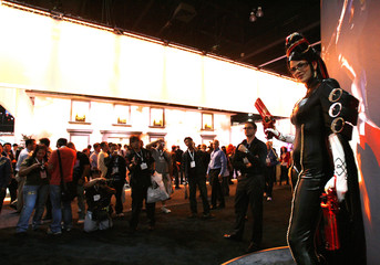 Penny Drake, dressed as the video game character Bayonetta, poses for photographs during the Electronic Entertainment Expo in Los Angeles
