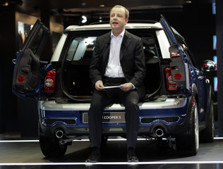 BMW AG Board of Management Member responsible for sales and marketing Stephen Krause talks about the rear split doors of the Mini Clubman during press days of the 2008 North American International Auto Show in Detroit