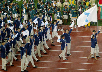 ATHLETES AND OFFICIALS FROM SOUTH AND NORTH KOREA ENTER TOGETHER FORTHE OPENING CEREMONY FOR ...