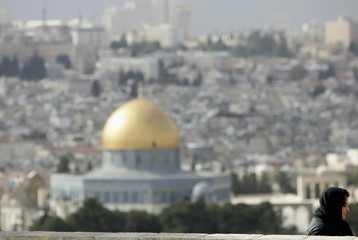 Tourist visits the Mount of Olives overlooking the Old City of Jerusalem
