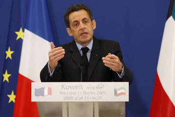 France's President Sarkozy attends a news conference at the Bayan Palace in Kuwait City