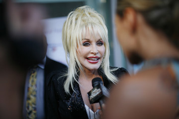 """Parton is interviewed at opening night of """"9 to 5: The Musical"""" at Ahmanson theatre in Los Angeles"""