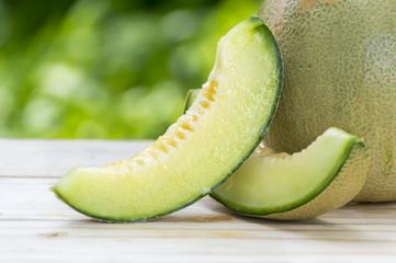 Ripe sweet melon on table in garden