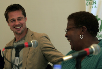 Brad Pitt laughs with Pam Dashiell, president of the Holy Cross Neighborhood Association, in New Orleans