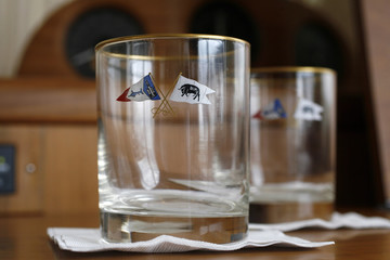 Monogramed drinking glasses sit on a table aboard the Rybovich M/V sportfish yacht, owned by Bernard Madoff, docked at the National Liquidators in Davie