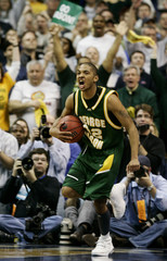 George Mason University's Campbell celebrates during regulation time against University of Connecticut at their men's NCAA basketball regional final in Washington