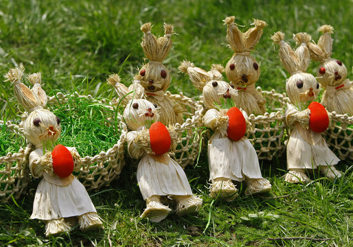 Traditionally hand crafted Easter Bunnies made of corn leaves are displayed for sale during a Palm Sunday fair at the Village Museum in Bucharest