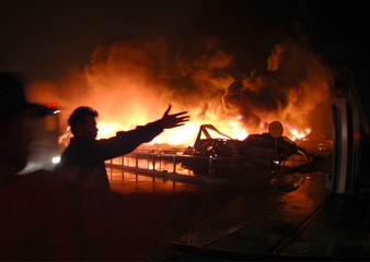 A fireman is seen near a raging fire at Pakistan National Refinery in Karachi.