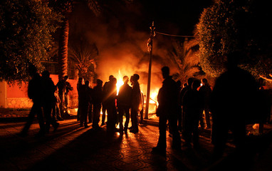 Fatah supporters burn cars inside the Palestinian parliament during protest in Gaza city
